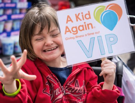 A Kid Again VIP Smiling Kid with Sign