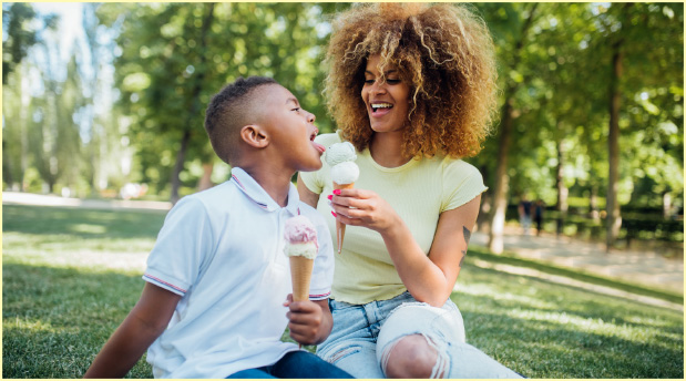 Mom and Son eating ice cream in the park
