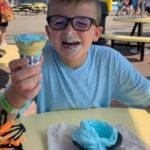 Smiling Kid eating Ice Cream Cone